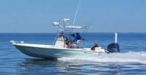 The fishing charter boat speeding by in the shallow waters of mississippi