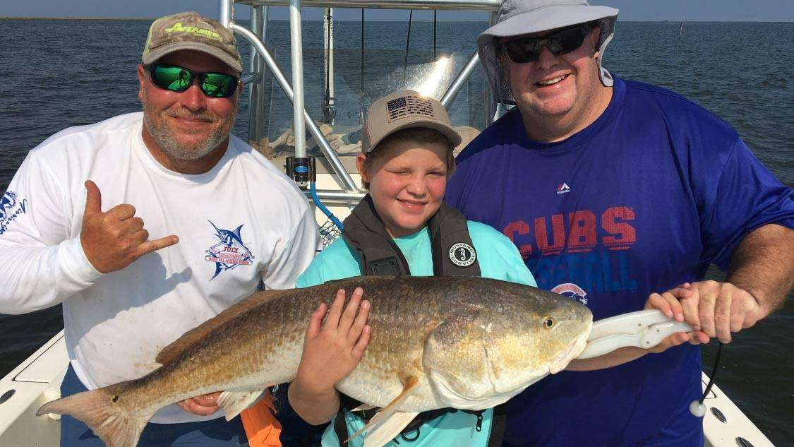 A picture of Biloxi Marsh Redfish with Legends of the Lower Marsh